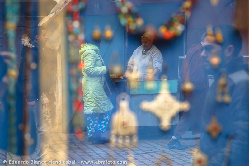 Shop and woman. Marrakech. Morocco. North Africa. Africa
